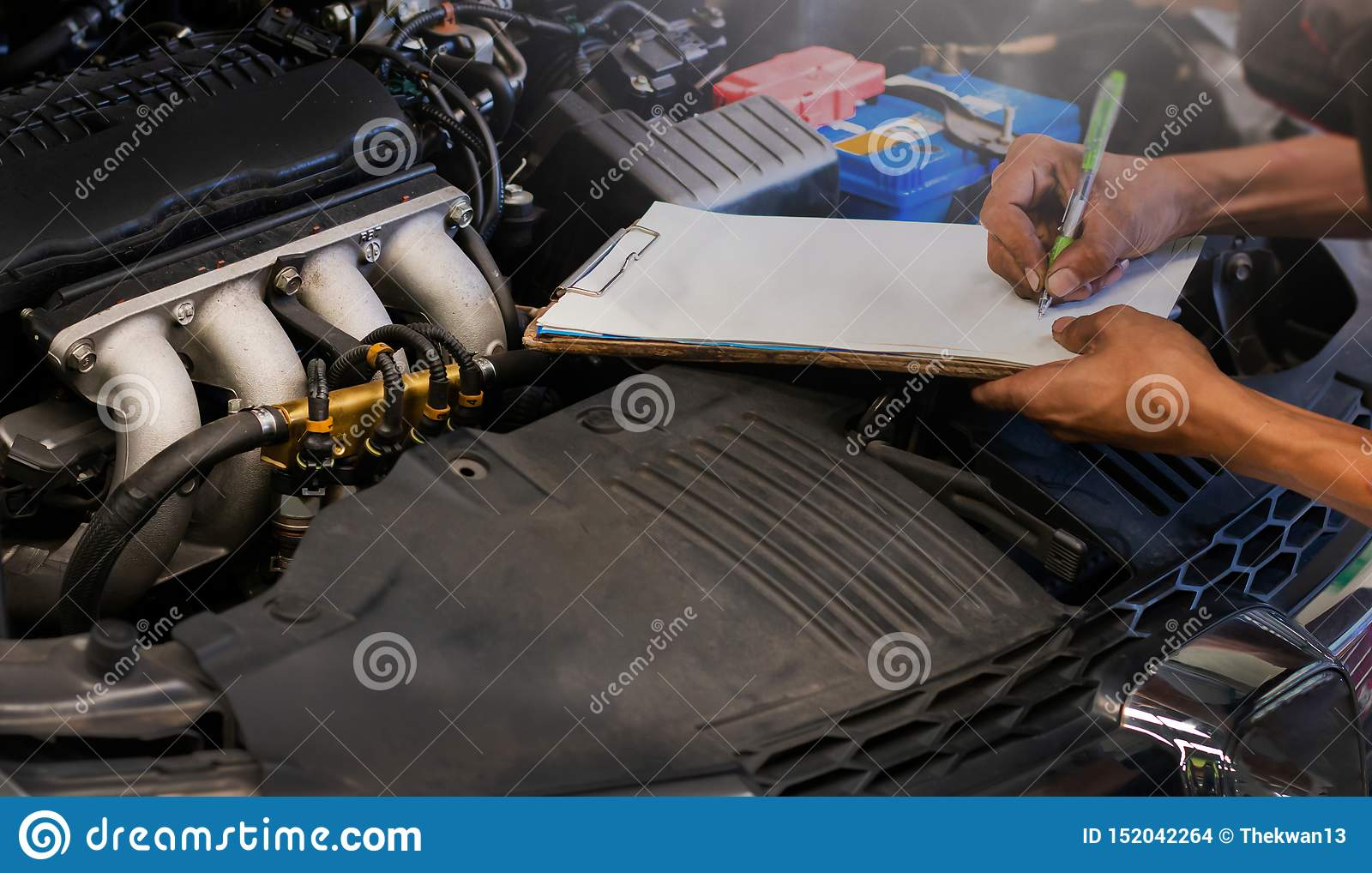 Mechanic check the car engine auto repair