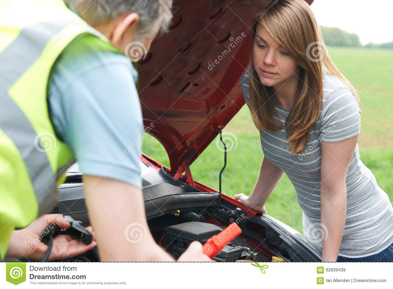 Mechanic Helping Broken Down Female Motorist