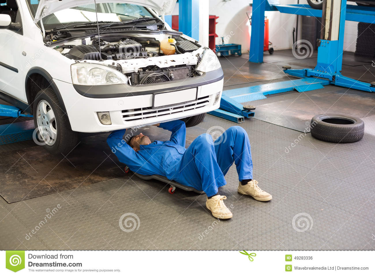 mechanic lying and working under car stock photo image of mechanic work 49283336. Black Bedroom Furniture Sets. Home Design Ideas