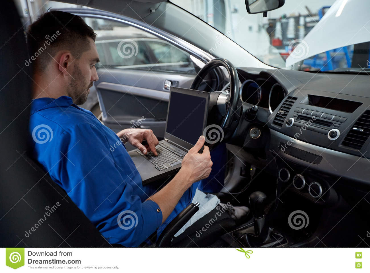 mechanic man with laptop making car diagnostic stock photo image 79979824. Black Bedroom Furniture Sets. Home Design Ideas