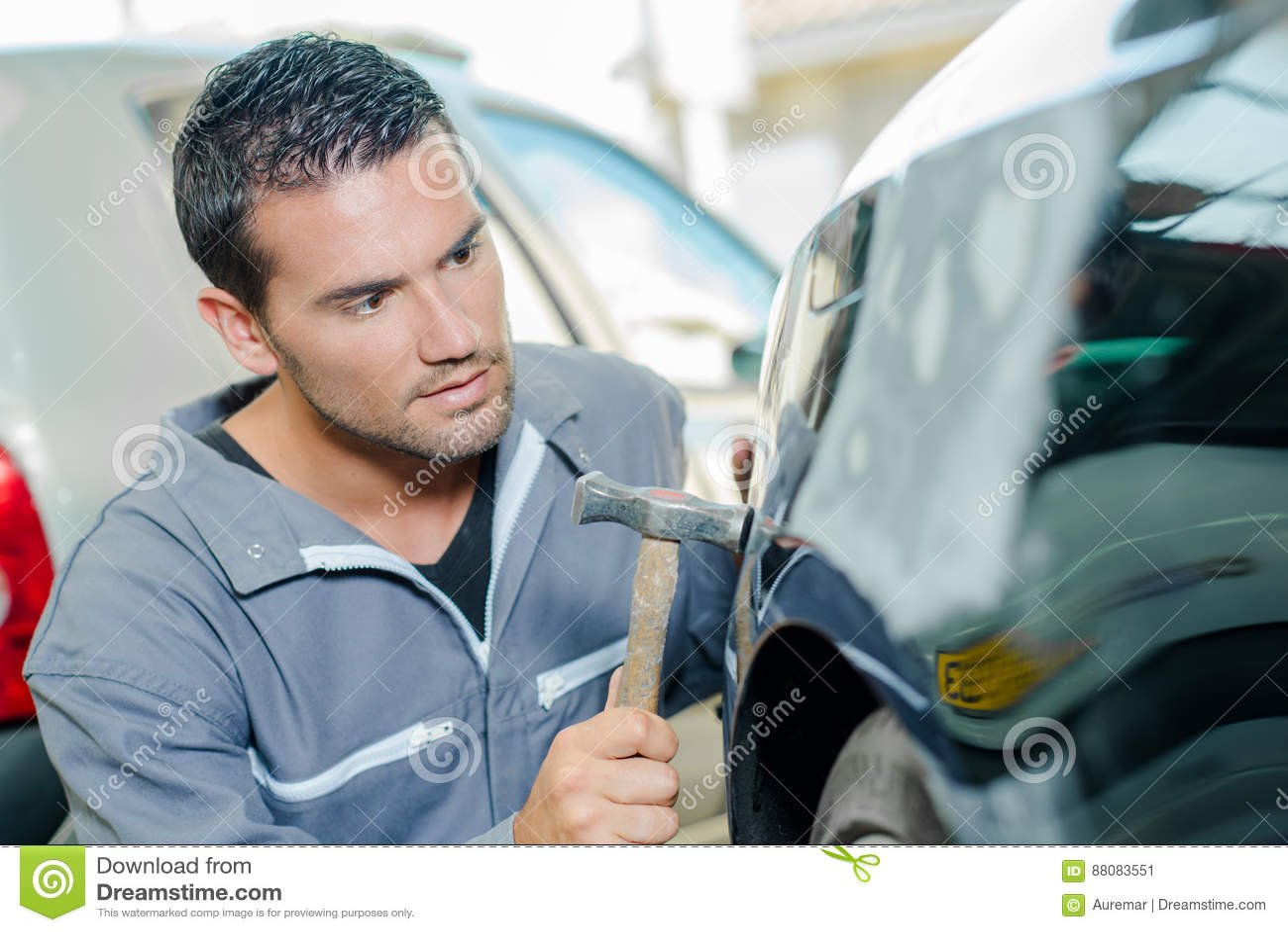 Mechanic panel beating car