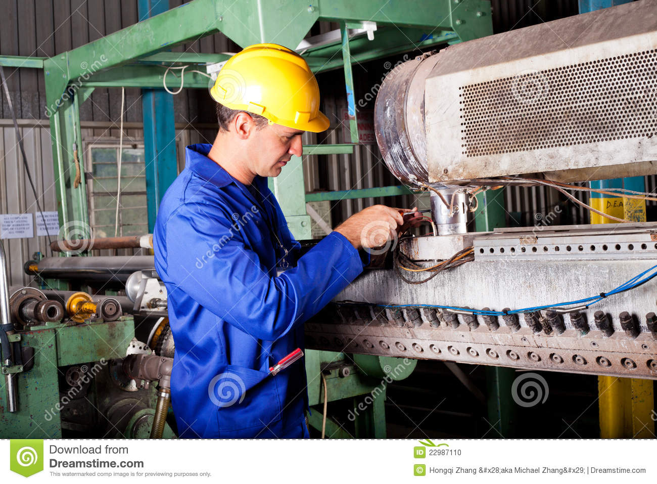 Mechanic repairing heavy machine