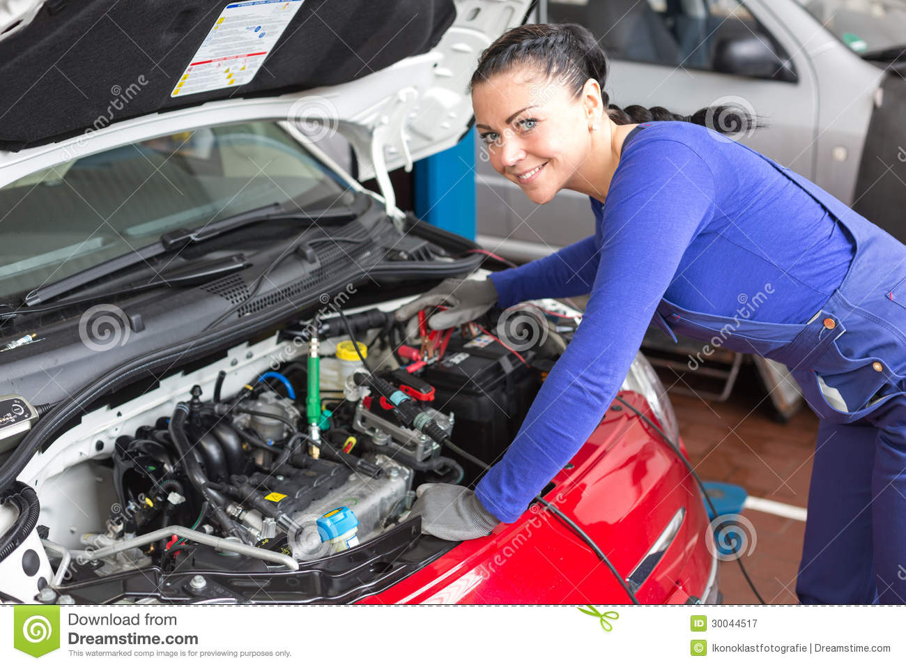 Mechanic Repairing A Car In A Workshop Or Garage Stock