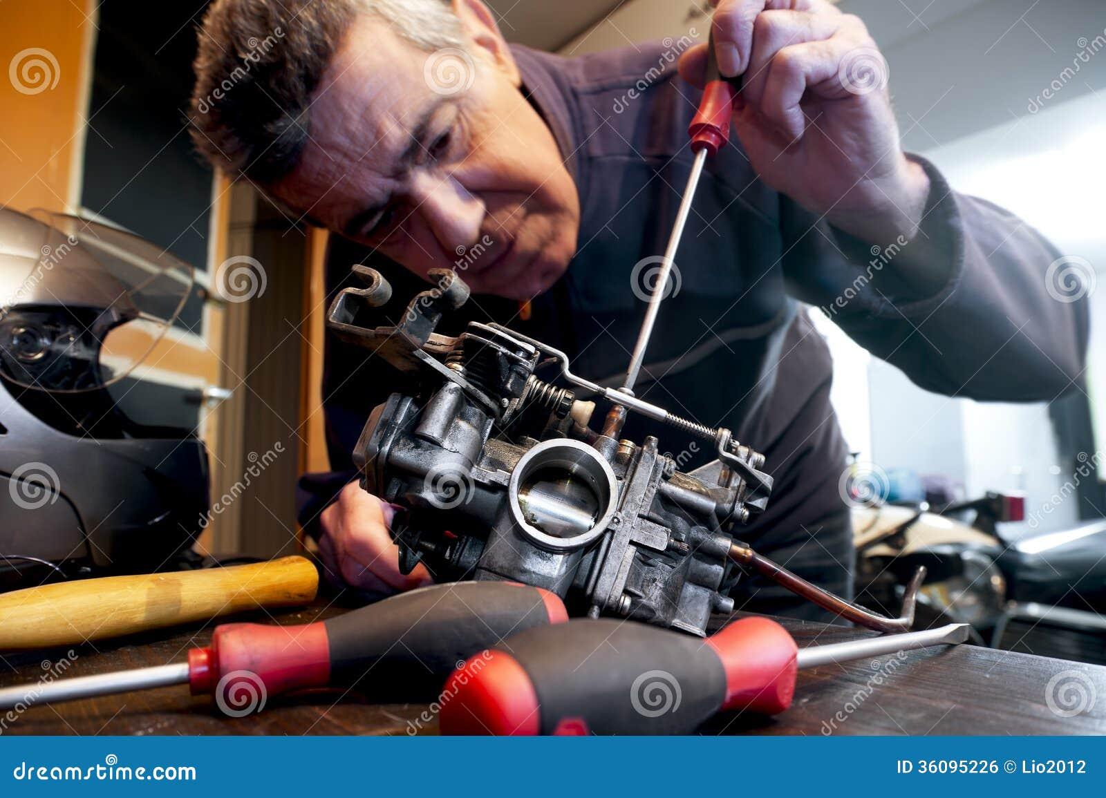 Mechanic Repairs A Carburetor Royalty Free Stock Image