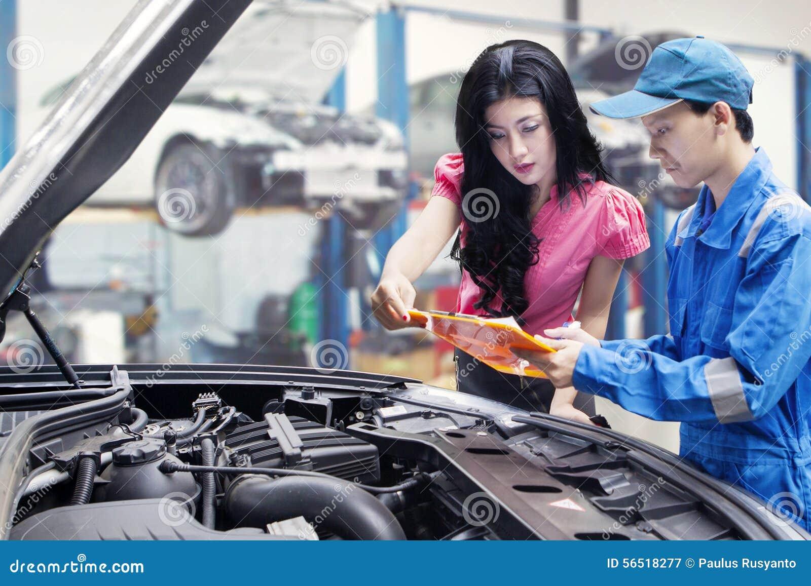 Mechanic Showing The Repair Cost Photo Image 56518277 – Machine Mechanic