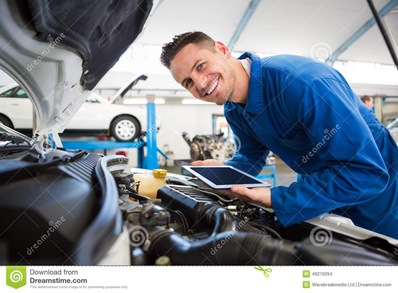 Mechanic Using Tablet On Car Stock Photo Image 49279394