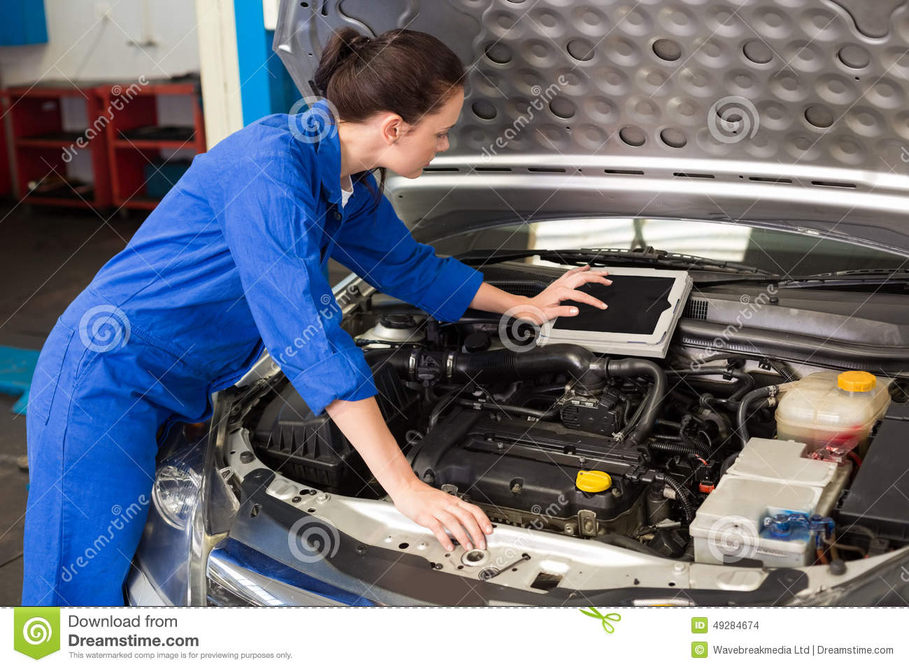 Mechanic using tablet to fix car stock photo image 49284674 for Garage fix auto nimes