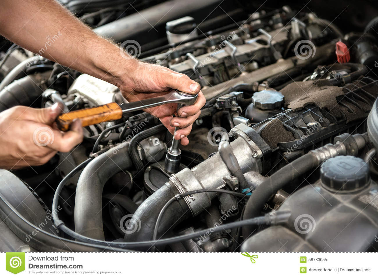 Mechanic Using A Wrench And Socket Stock Photo Image 56783055