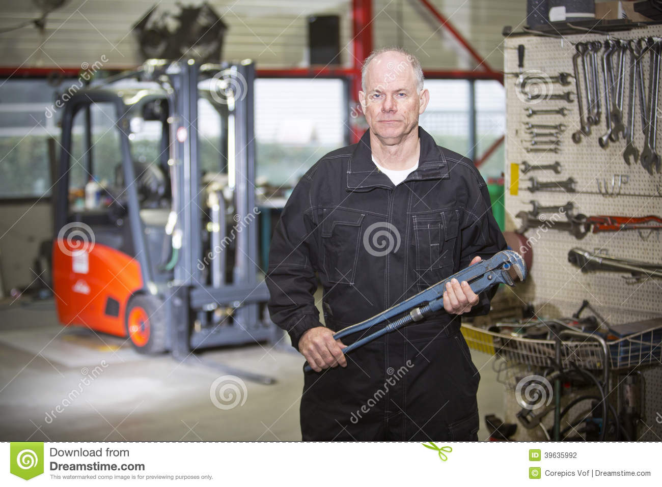 Mechanic With Wrench Stock Photo Image - Forklift mechanic