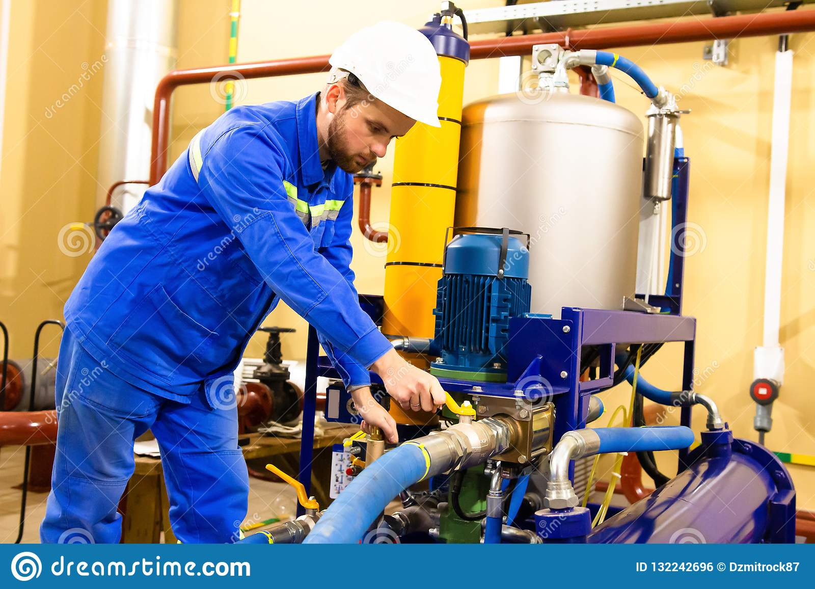 Mechanical engineer services industrial oil equipment on gas refinery.