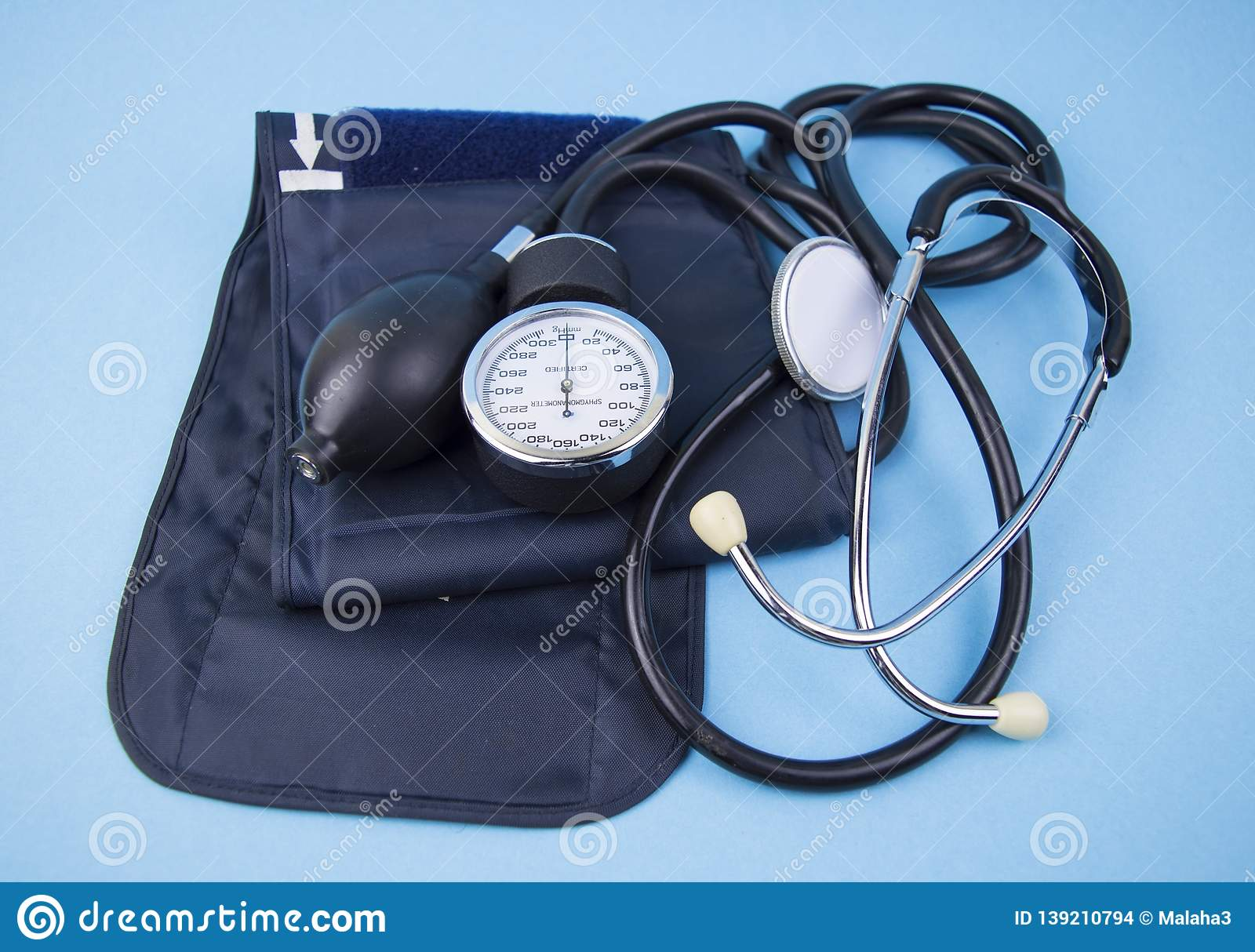 Mechanical tonometer on a blue background - a device for measuring blood pressure