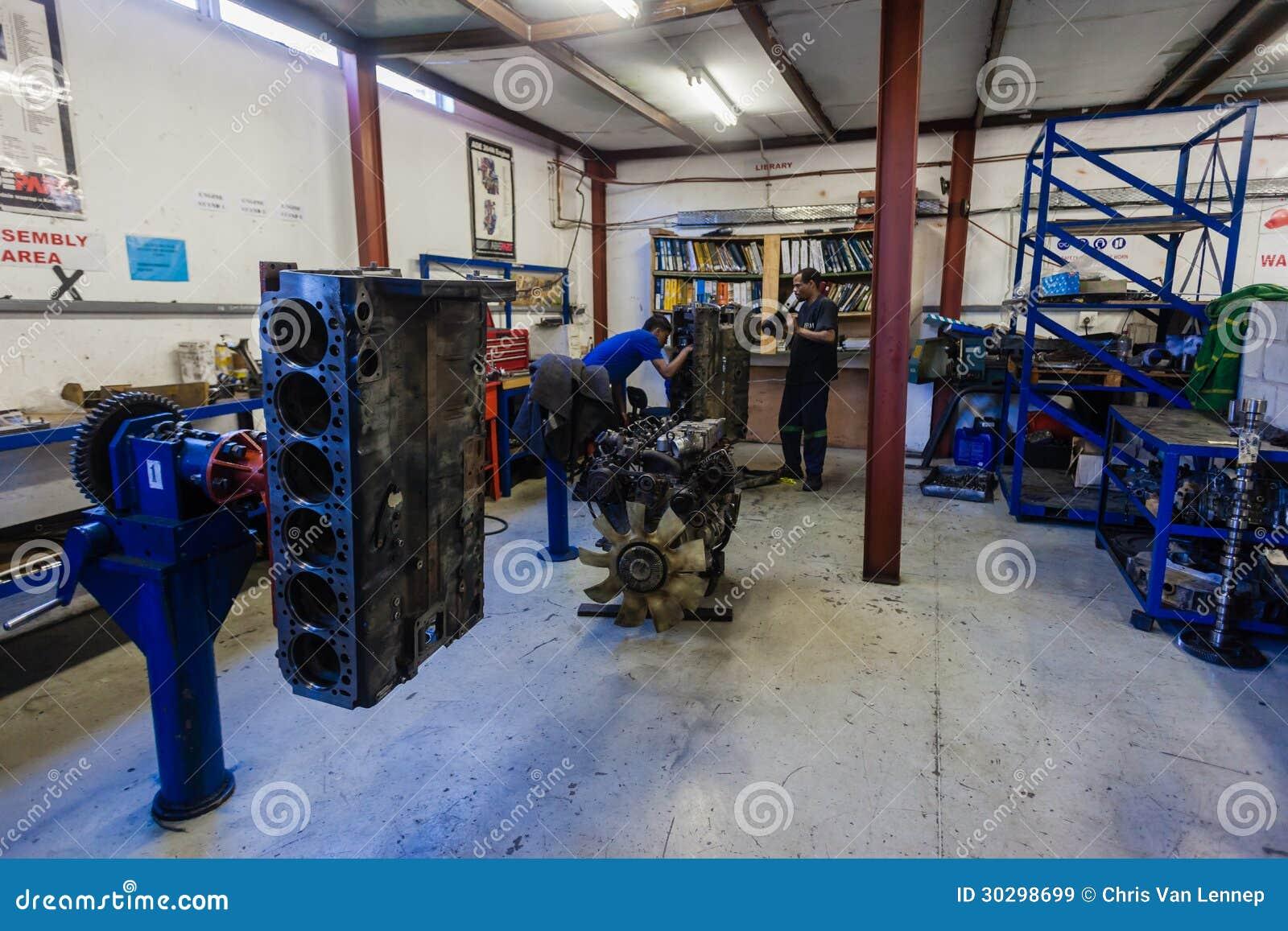 Mechanics repairing and rebuilding large diesel engine blocks.JBM ...