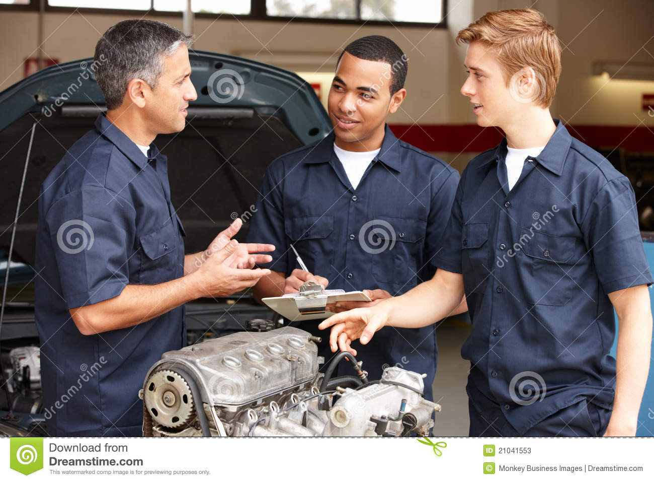 Tune Up Prices >> Mechanics At Work Stock Photos - Image: 21041553