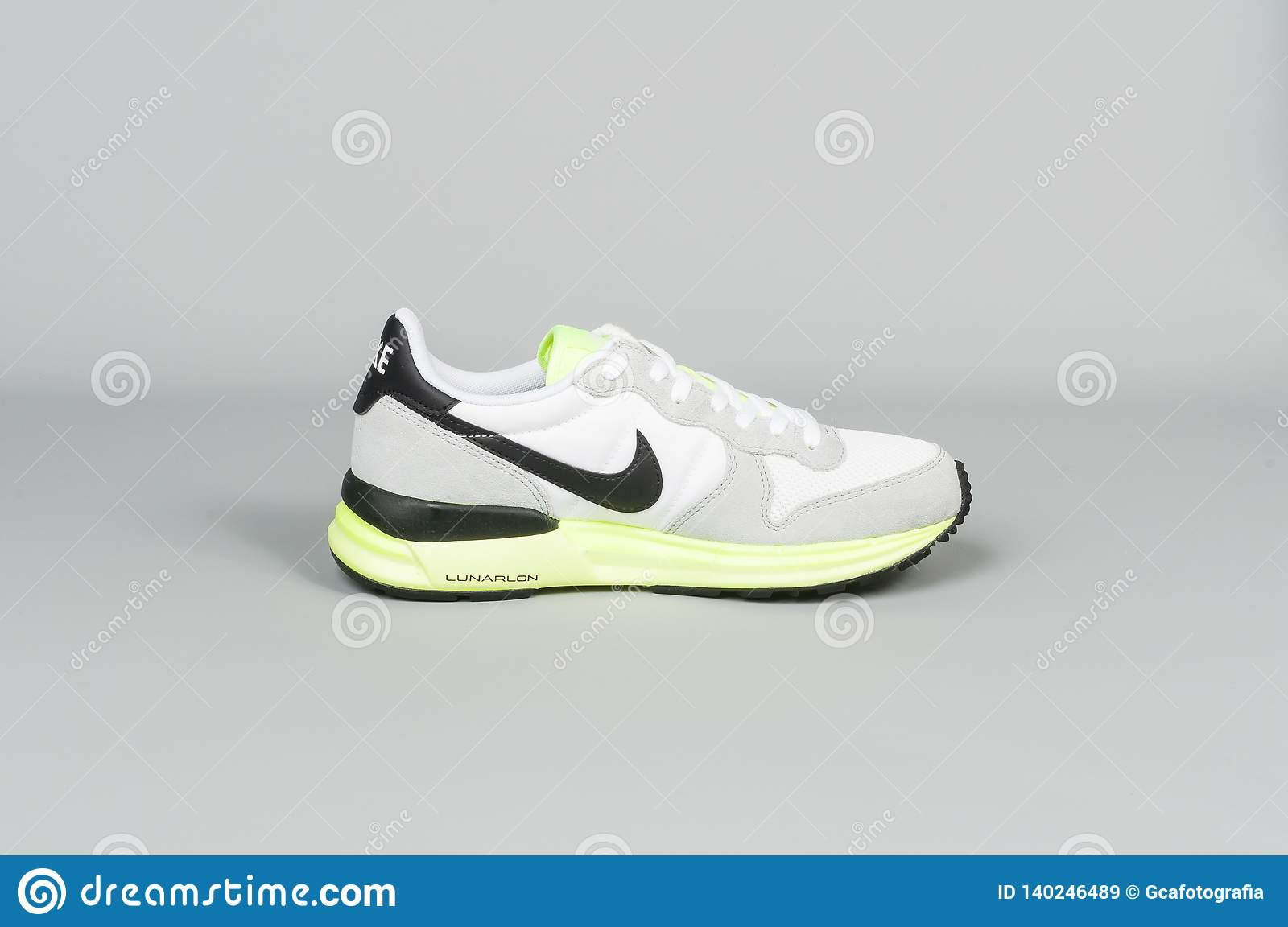 16140210 Medellin, Colombia- February 23, 2019: NIKE sports shoes on gray background