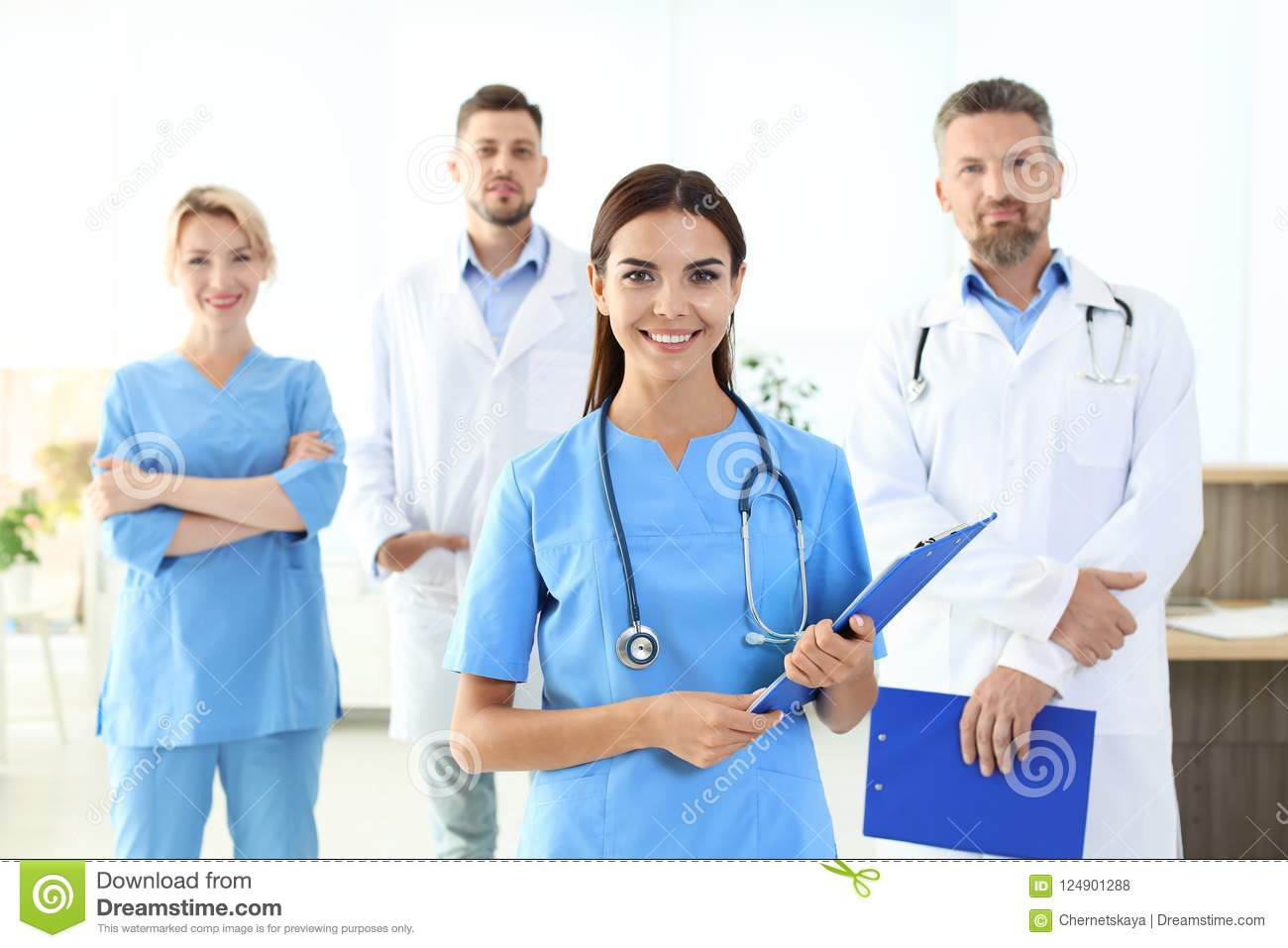 Medical assistant with colleagues in clinic