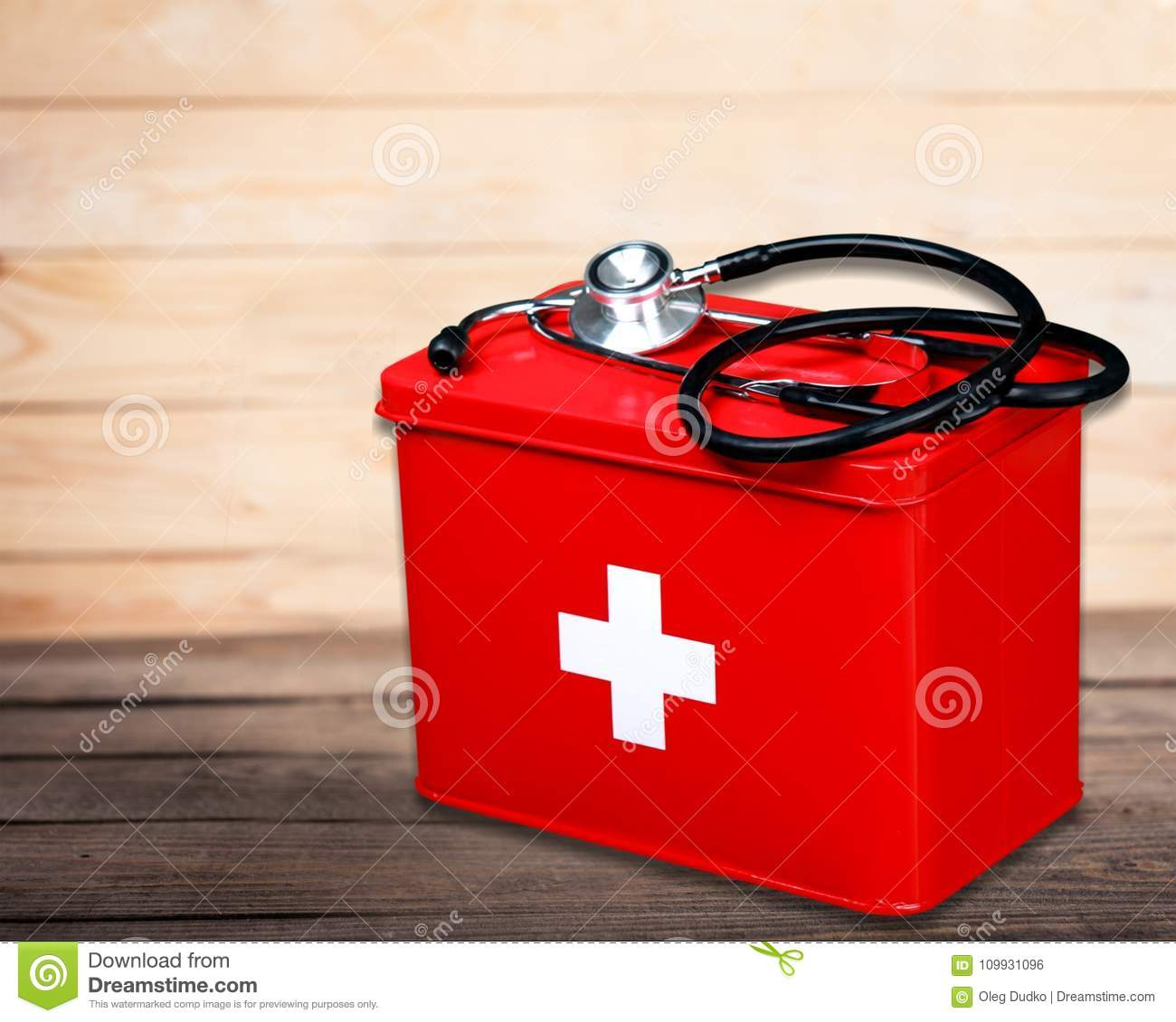 First Aid Kit With Medical Supplies On Wooden Stock Photo - Image of