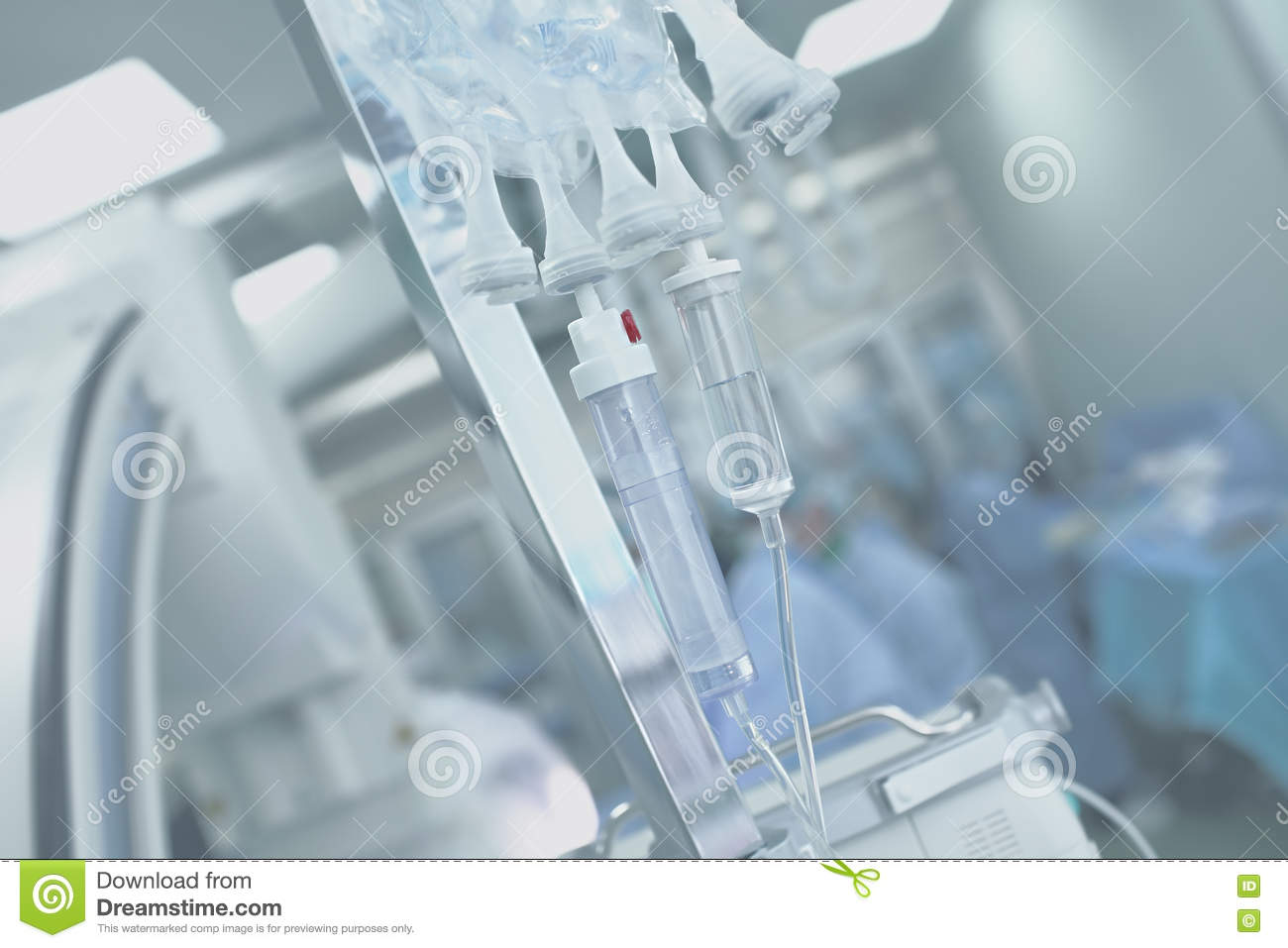 Medical IV drip systems on a background of the operating room