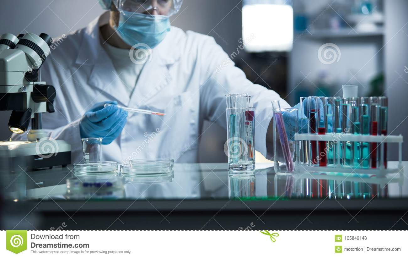 Medical lab assistant taking genetic material for examination on paternity