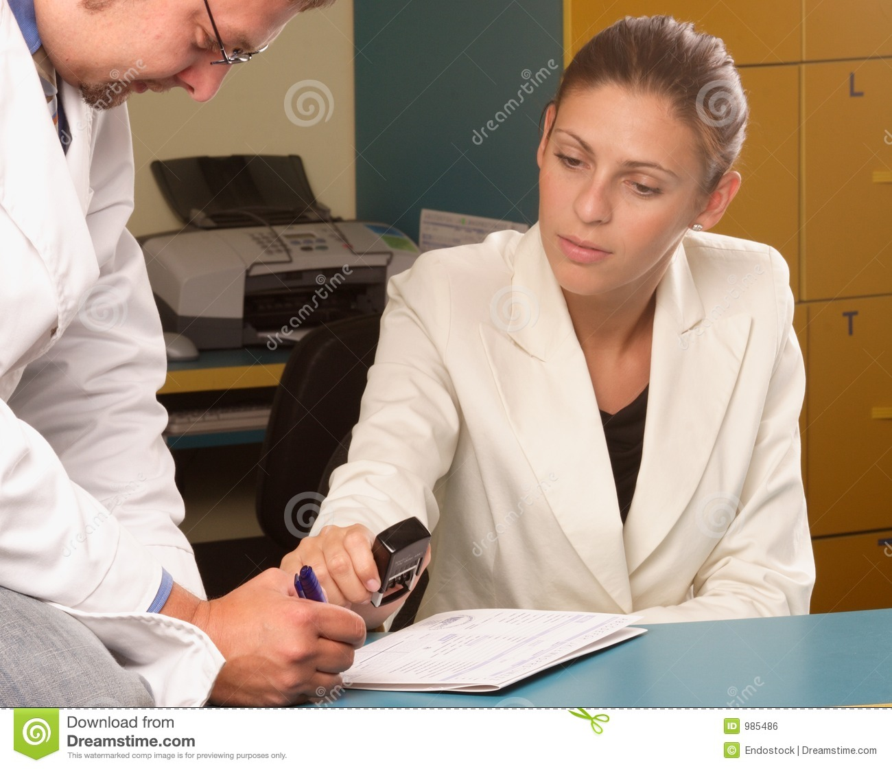 Medical Secretary And Doctor Working Together Stock Photo ...