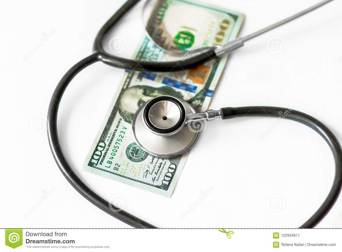 Medical stethoscope on hundred dollar banknote money on white background. Concept of health care costs, finance, health