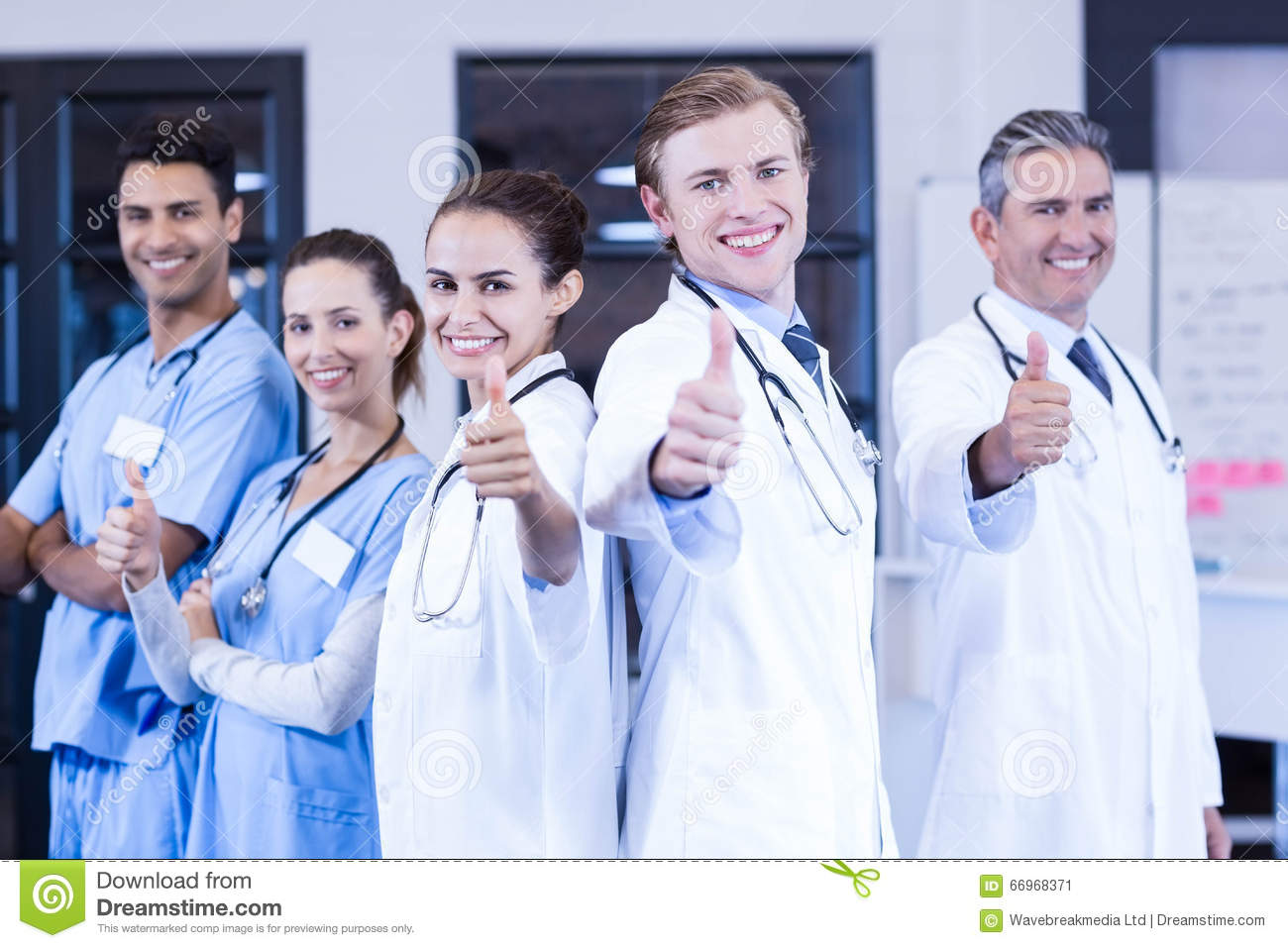 Medical team putting their thumbs up and smiling