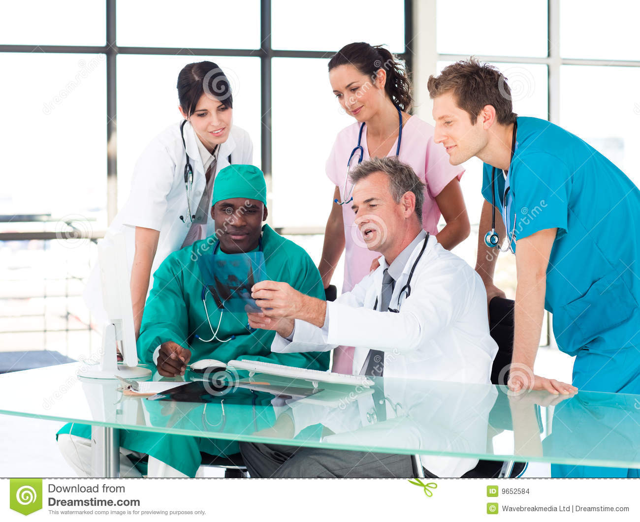 Medical team studying an X-ray