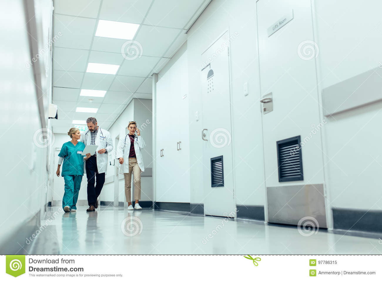 Medical team walking down hallway at the hospital