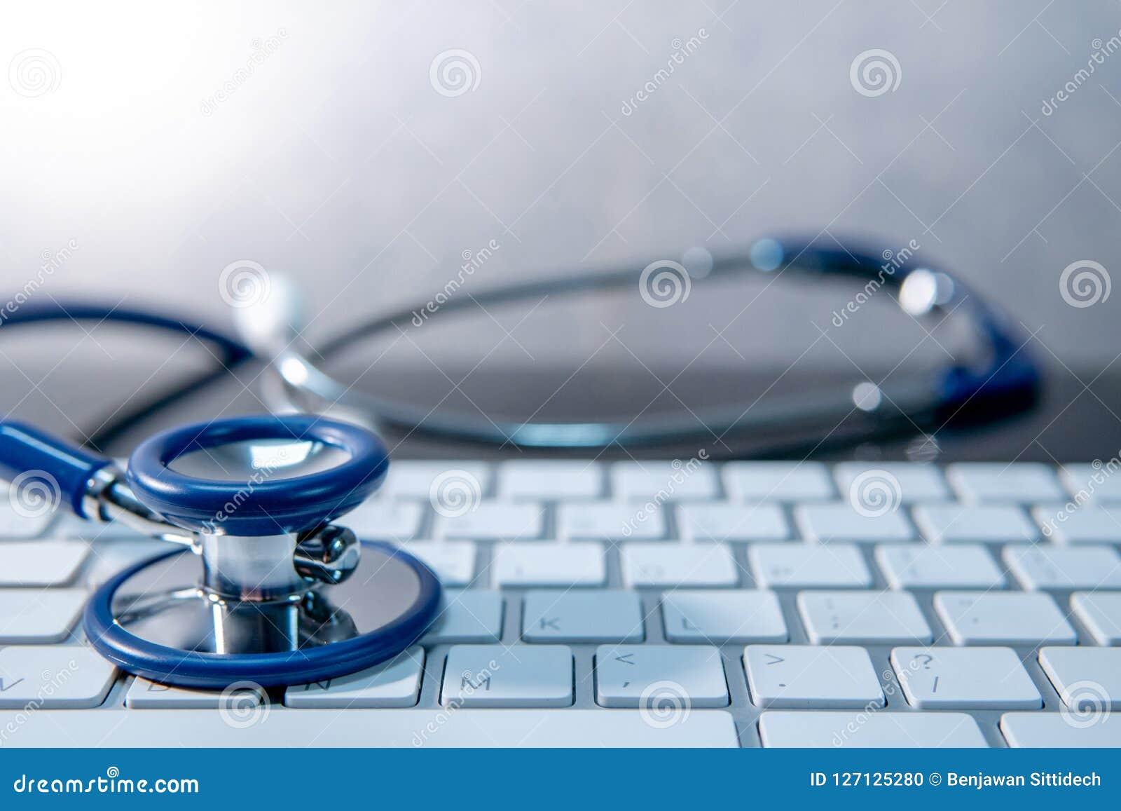 Medical technology. Stethoscope on white keyboard