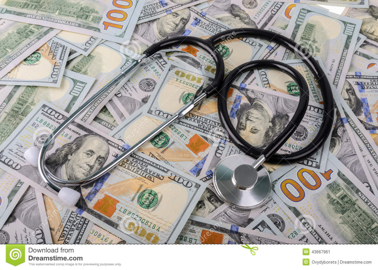 Medical treatment and cost concept: stethoscope placing on US dollars banknotes