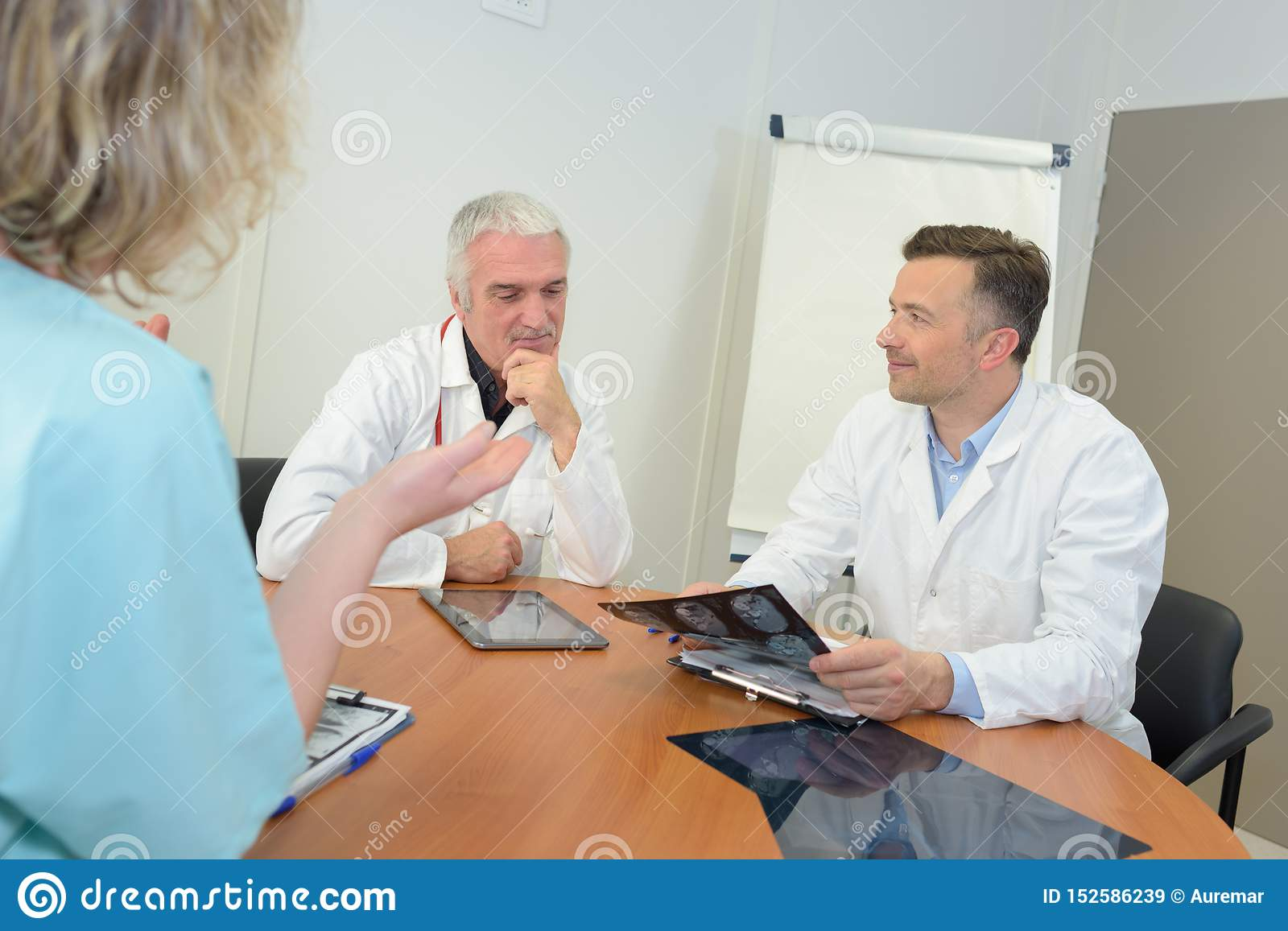 Medical workers dicussing xray results