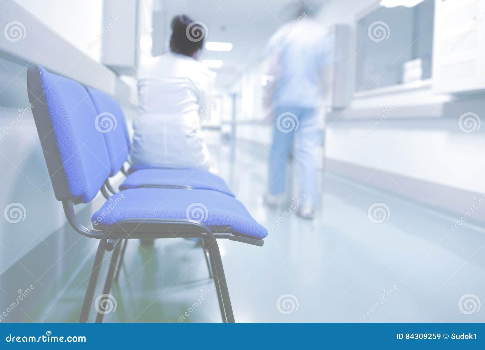 Medical workers in hospital hallway