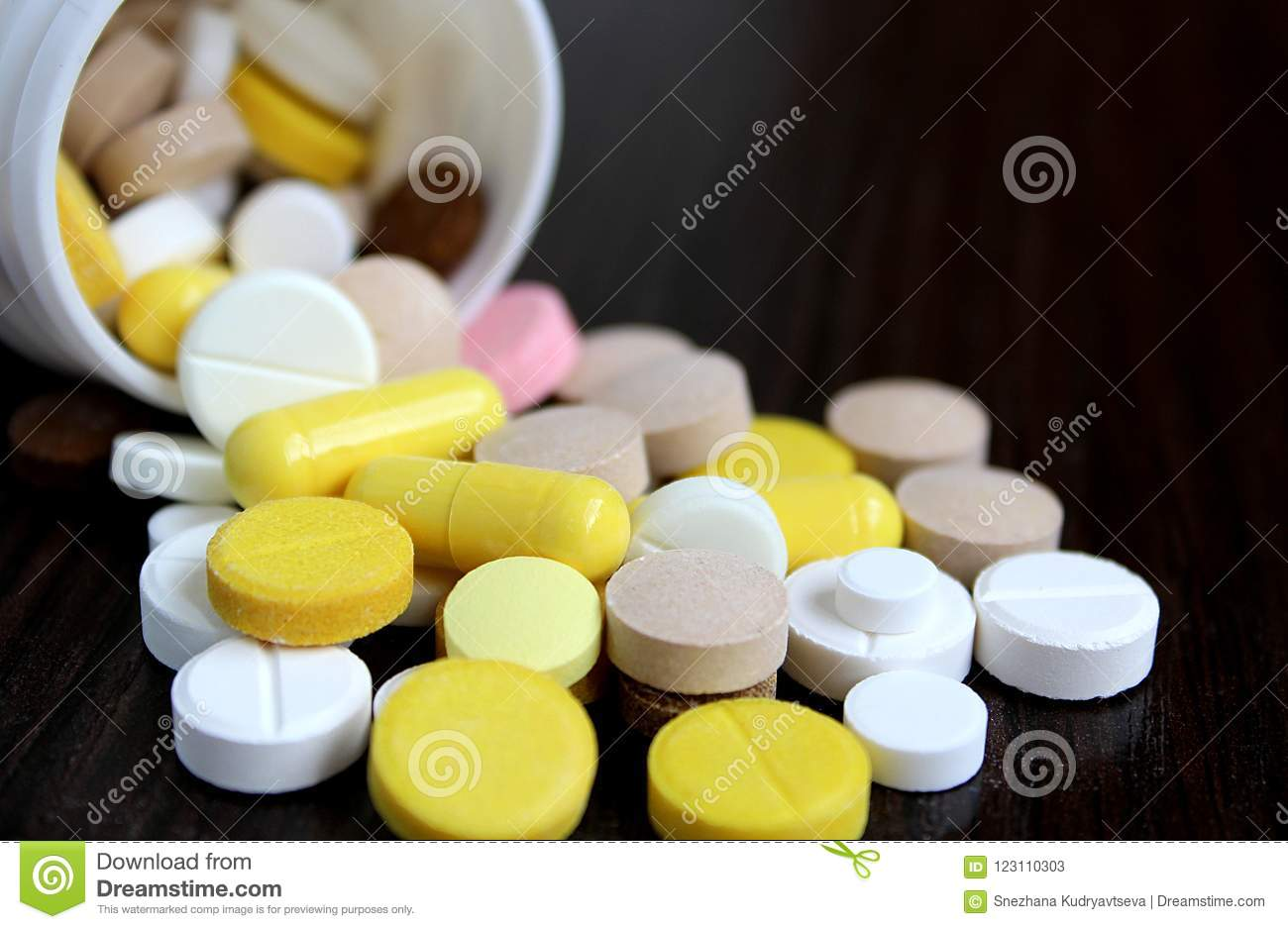 Medication Tablets Are Capsized On The Table Stock Image