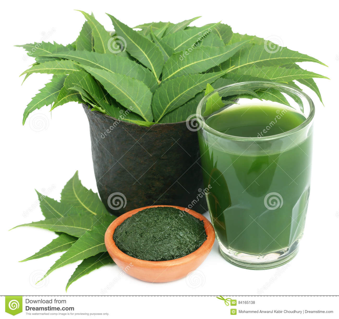 Medicinal Neem Leaves With Extract And Ground Paste Stock Photo