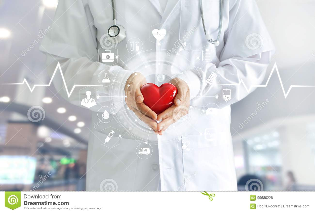 Medicine doctor holding red heart shape in hand and icon medical
