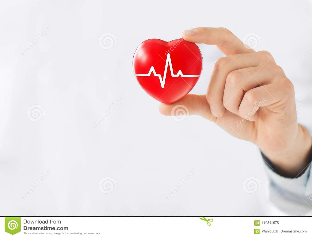 Medicine doctor holding red heart shape in hand with medical icon network connection modern virtual screen interface, service mind