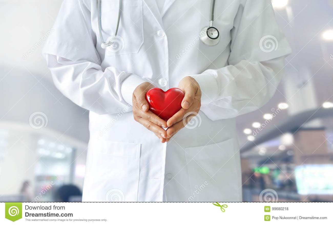 Medicine doctor holding red heart shape, medical techno