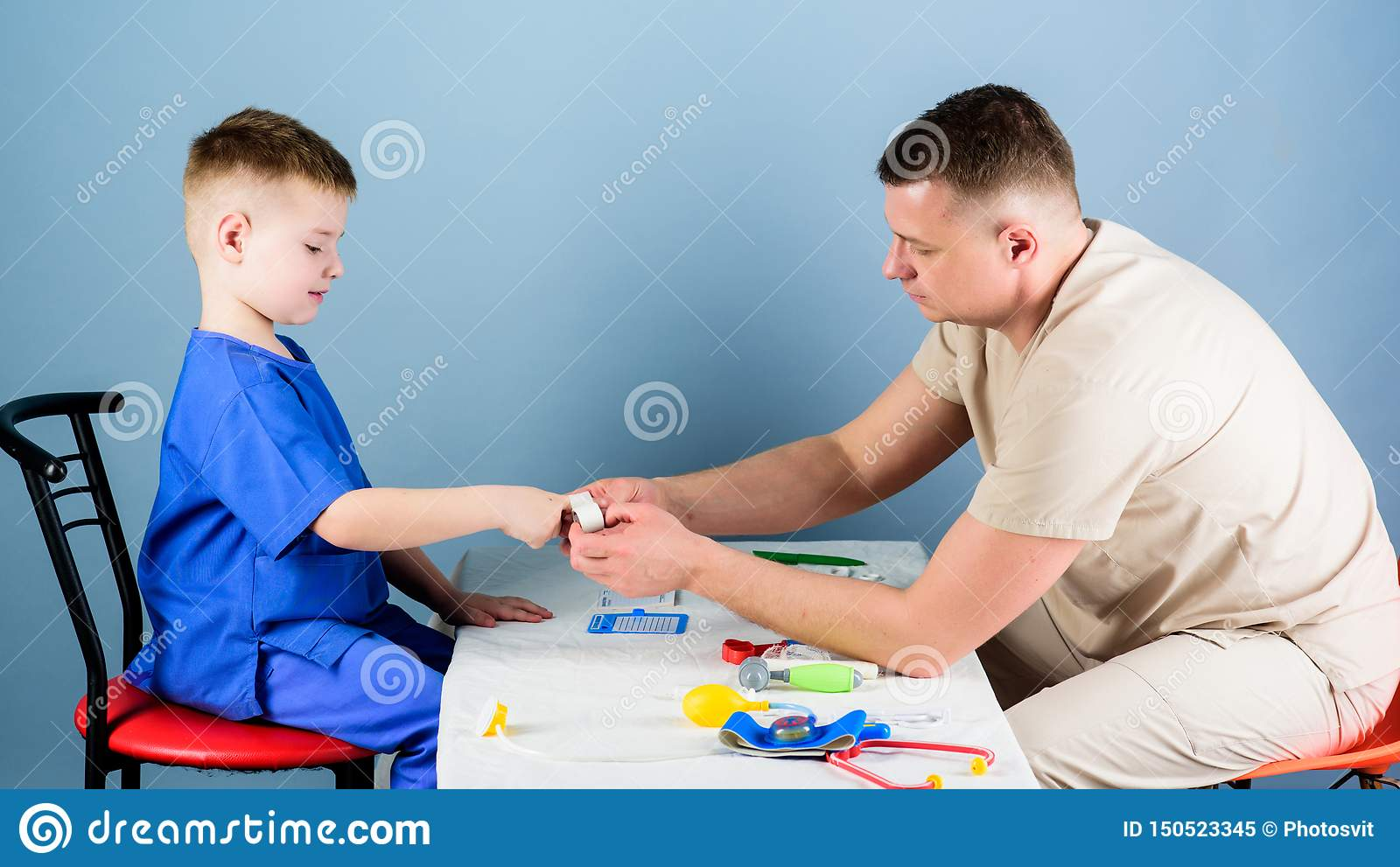 Medicine and health. small boy with dad play. pediatrician intern. nurse laboratory assistant. happy child with father