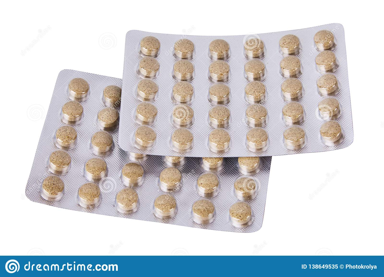 Medicine herbal pills or tablets in silver blisters on white background.