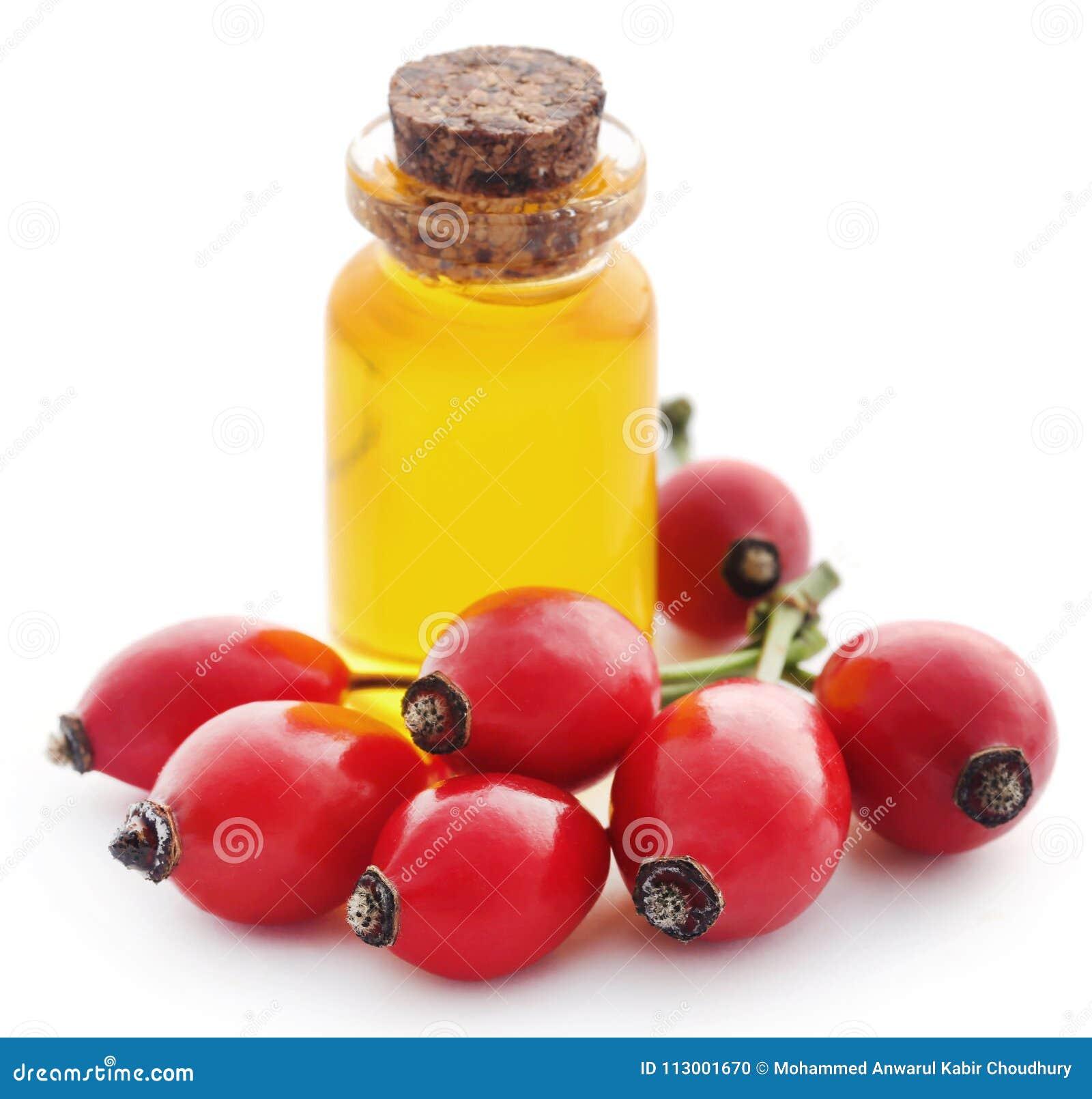 Medicinska rosa höfter med nödvändig olja