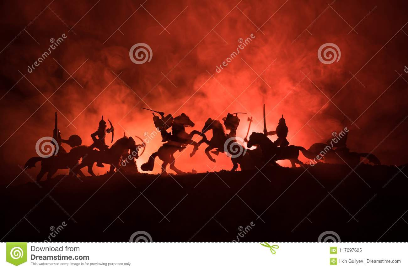 Medieval battle scene with cavalry and infantry. Silhouettes of figures as separate objects, fight between warriors on dark toned
