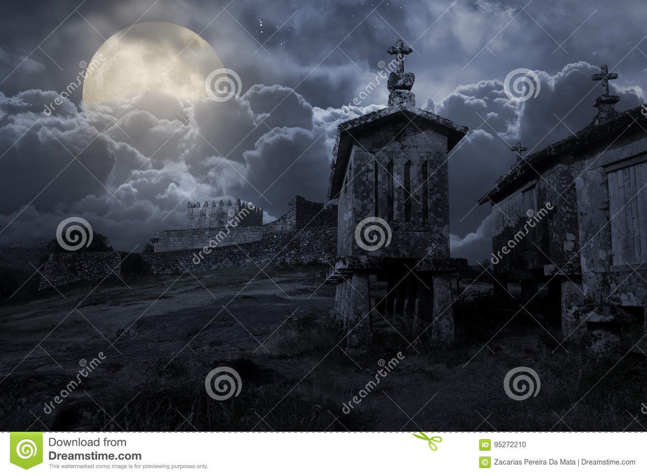 Medieval castle in a cloudy full moon night