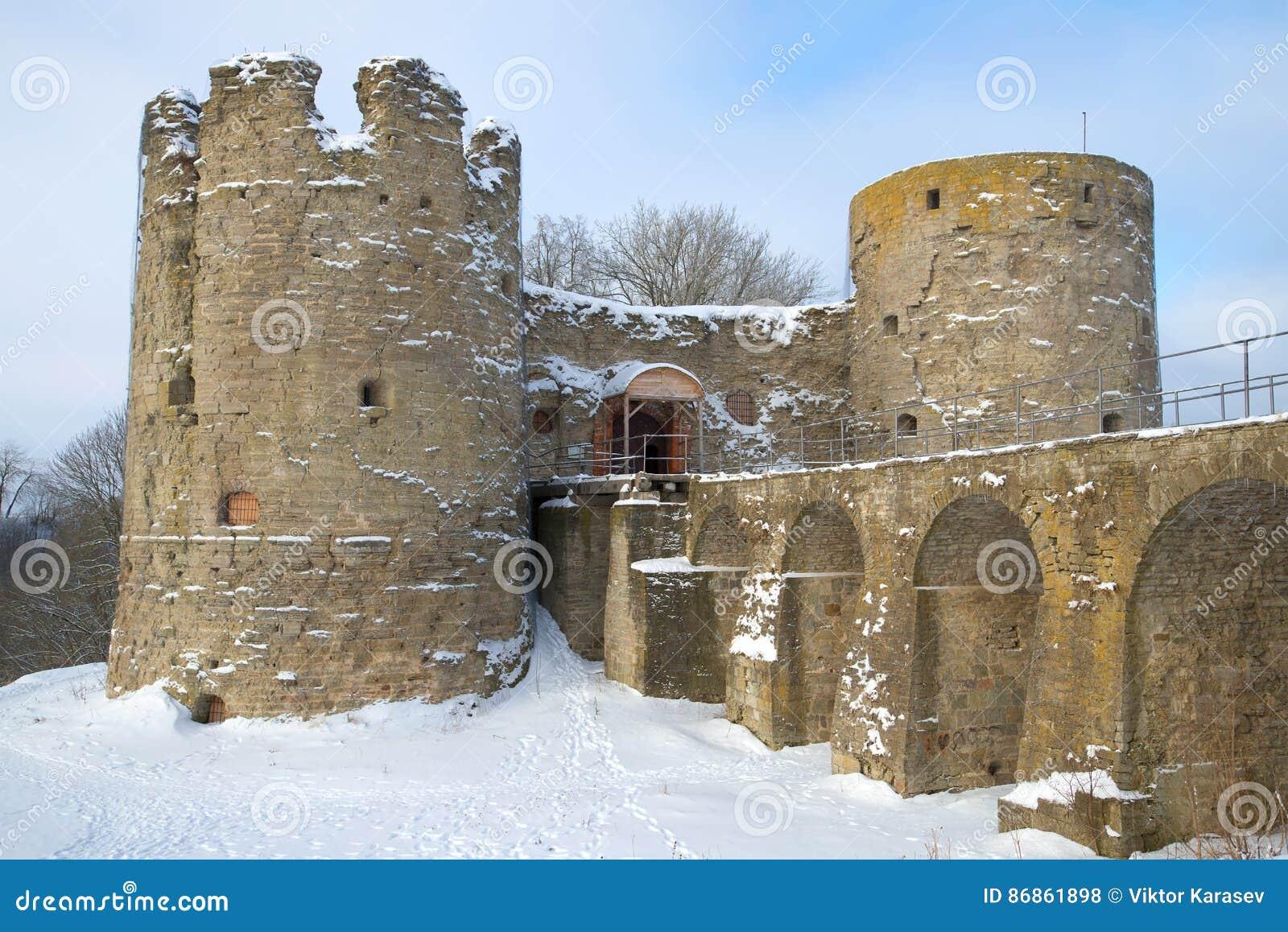 Medieval fortress Koporye closeup, cloudy February day. Leningrad region, Russia
