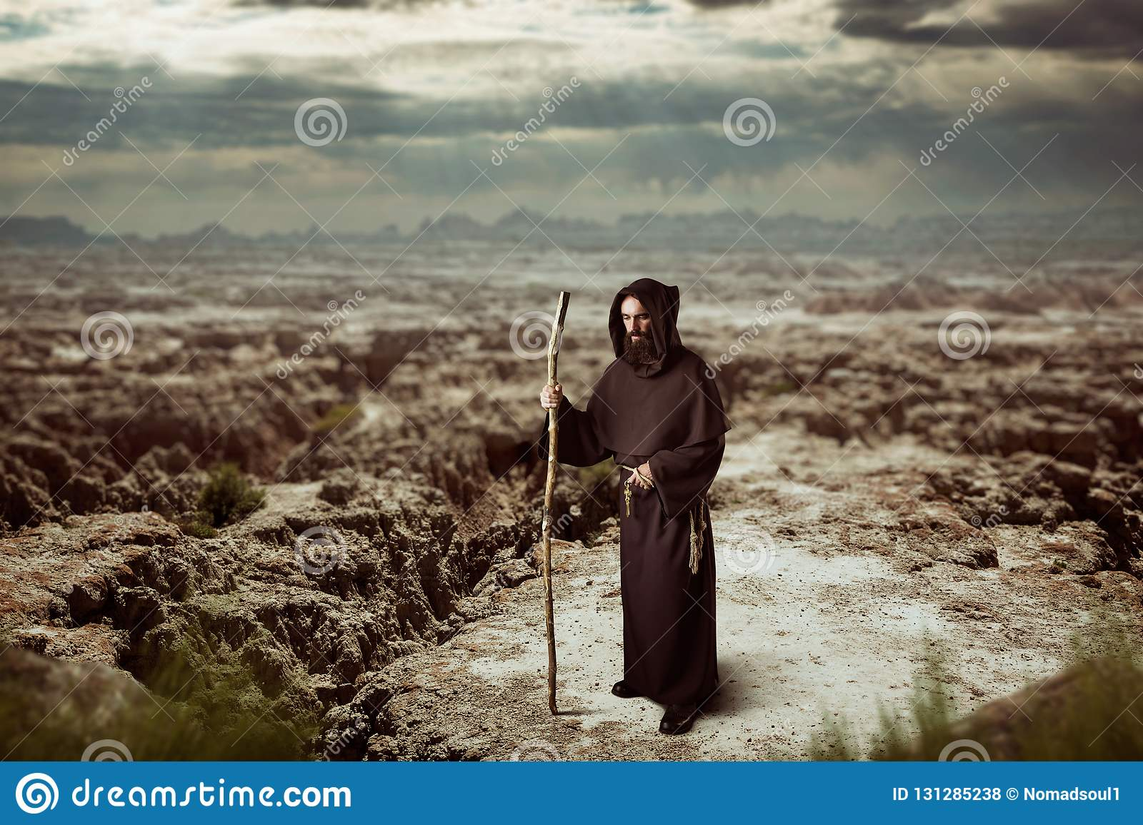 f6efdae525 Medieval monk in robe with hood rests on a stick stock photo image jpg  1600x1156 Medieval