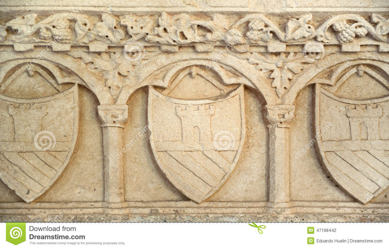 Medieval shield in stone wall texture backgrouund. Medieval Shield In Stone Wall Texture Backgrouund Stock Photo