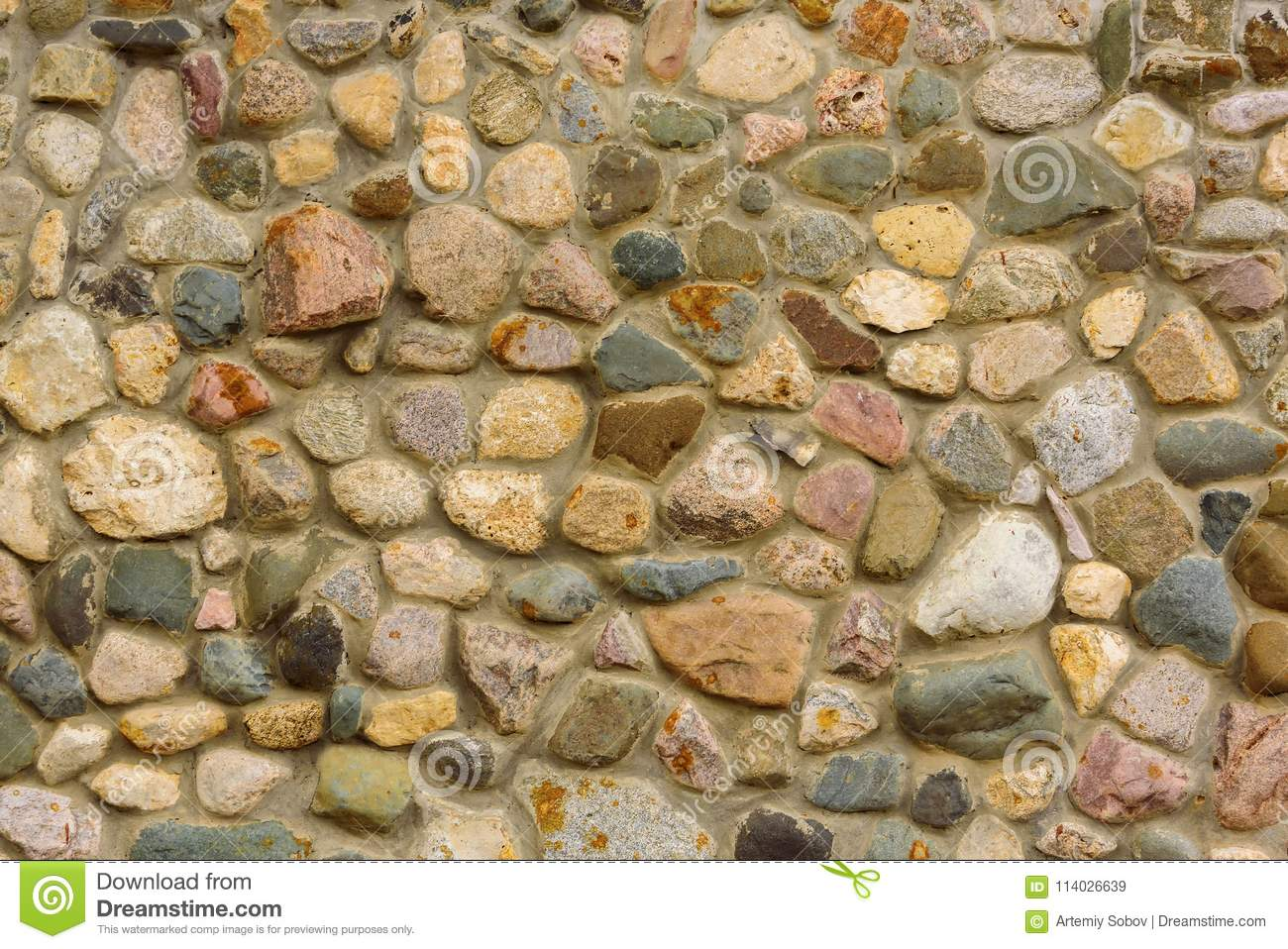 Medieval stone wall. Background made of natural solid stone.