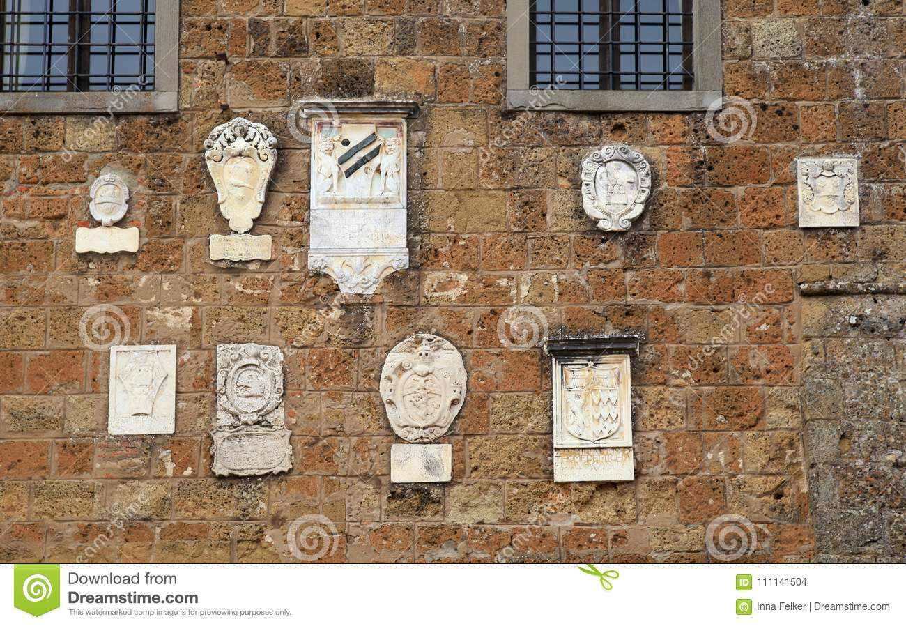 Medieval stone wall with bas-reliefs, Italy.