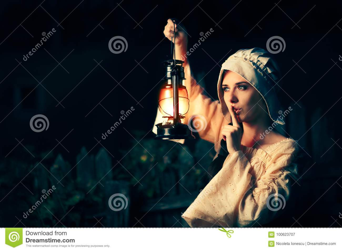 Medieval Woman With The Finger On The Lips Holding A Lamp Stock ... for Girl Holding Lamp  76uhy