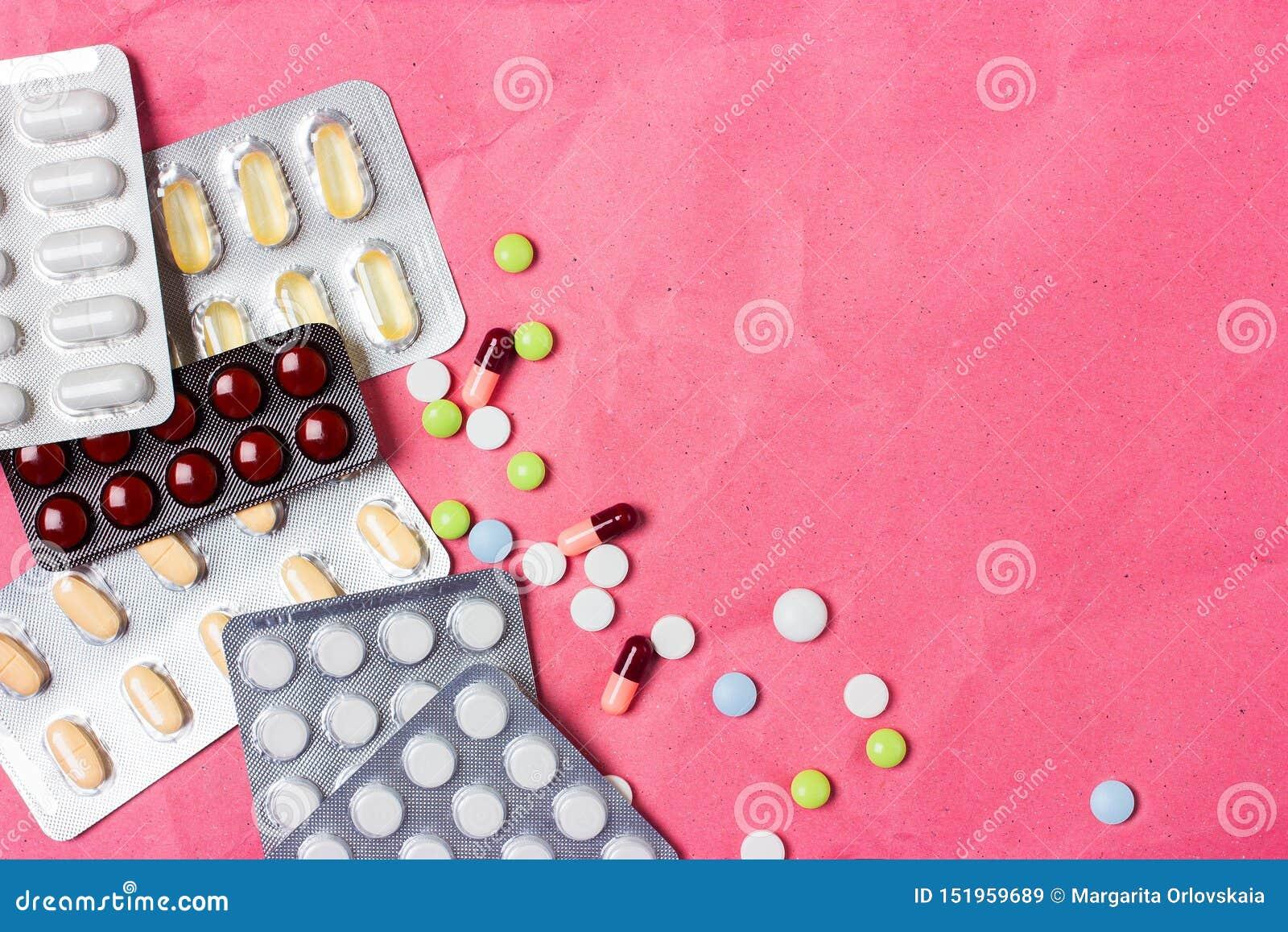 Medische achtergrond met kleurrijke pillen, tabletten en capsules voor een dia of een presentatie