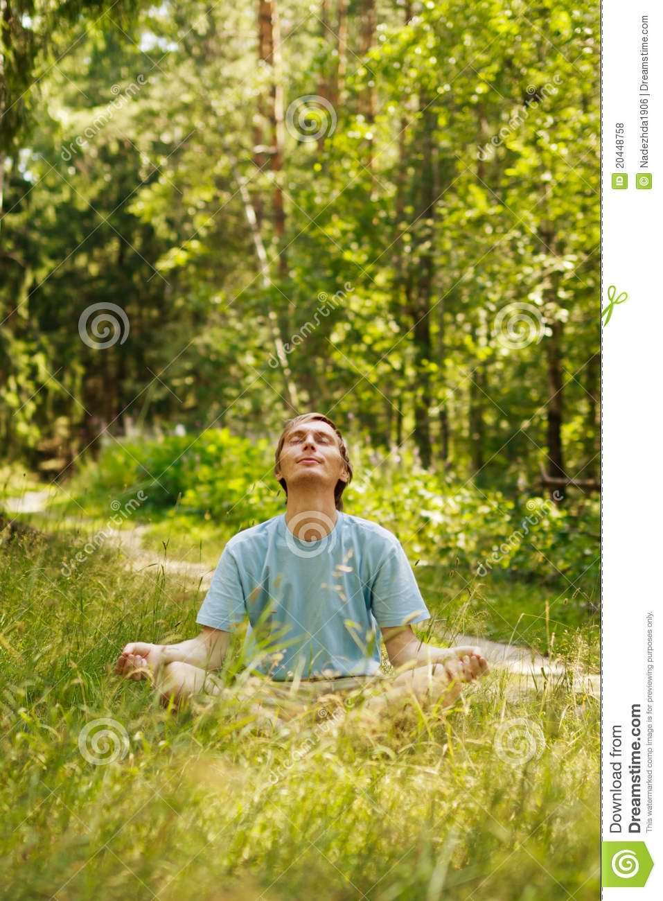 Old Woman Doing Yoga Meditation Exercises In Grass High