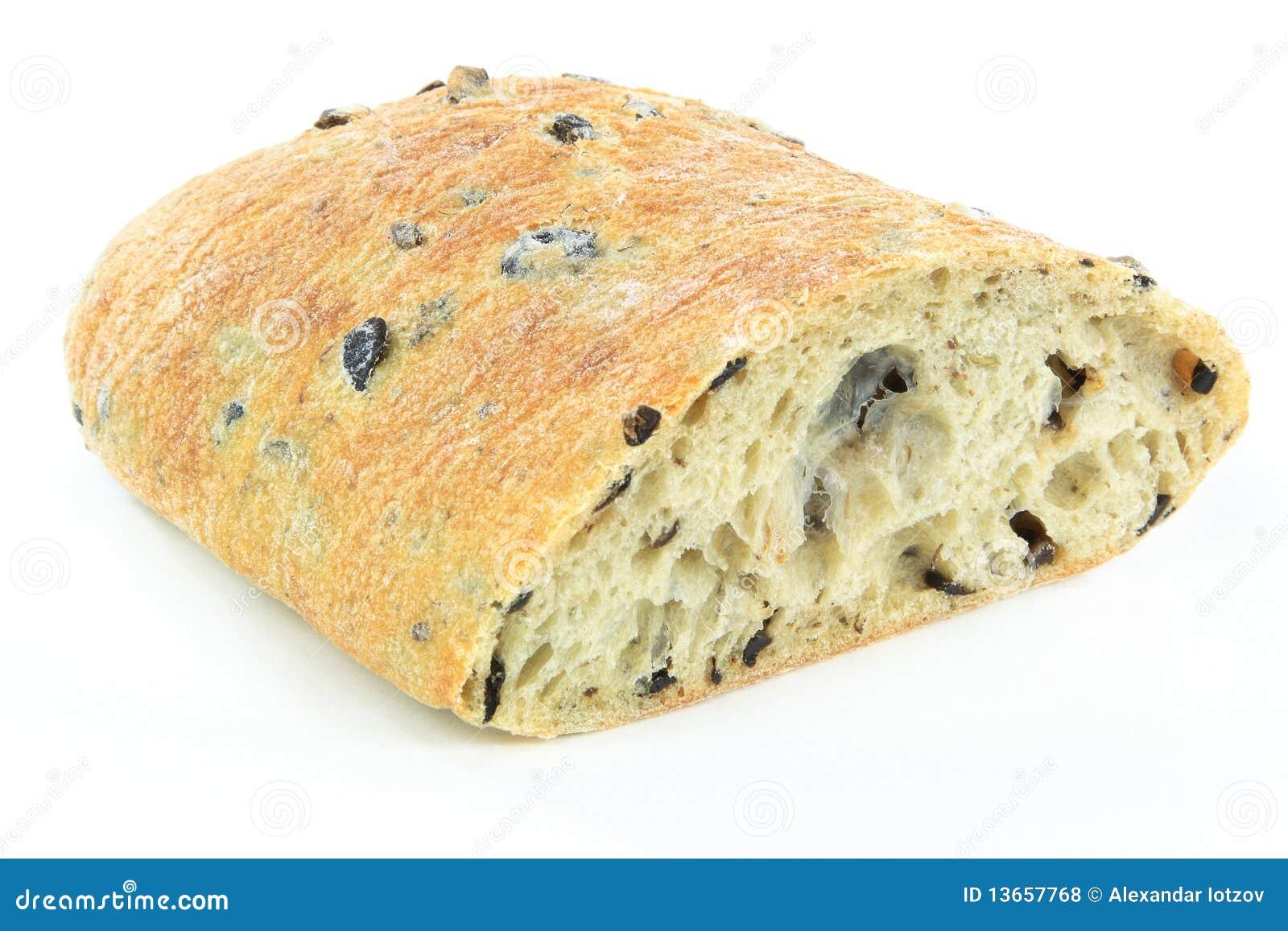 Cut on half Loaf Mediterranean Ciabatta black olive bread over white ...
